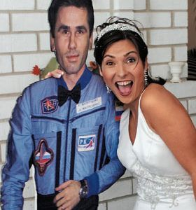 RUSSIAN SPACE BRIDE POSES WITH CUT OUT OF BRIDEGROOM
