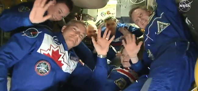 exp57_crew_greeting